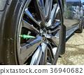 Close shot of chrome rims on a black car 36940682