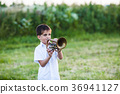 Little boy with musical instrument 36941127
