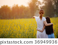 Happy Asian girl and mom walking on flower field 36949936