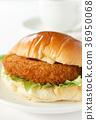 bread roll sandwich with croquette filling, baker, bread 36950068