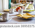 Beautiful festive dinner table colorful yellow 36950375