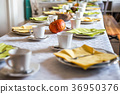 Beautiful festive dinner table colorful yellow 36950376