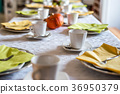 Beautiful festive dinner table colorful yellow 36950379