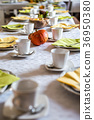 Beautiful festive dinner table colorful yellow 36950380
