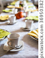 Beautiful festive dinner table colorful yellow 36950382