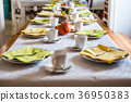 Beautiful festive dinner table colorful yellow 36950383