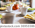 Beautiful festive dinner table colorful yellow 36950386