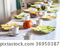 Beautiful festive dinner table colorful yellow 36950387