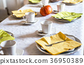 Beautiful festive dinner table colorful yellow 36950389