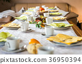 Beautiful festive dinner table colorful yellow 36950394