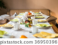 Beautiful festive dinner table colorful yellow 36950396
