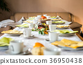 Beautiful festive dinner table colorful yellow 36950438