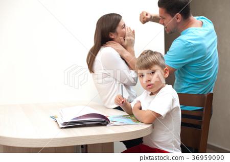 Parent quarrel - husband beats his frightened wife 36959090