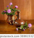 Oil and flowers of milk thistle on wooden . 36961532