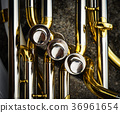 flaps of the brass sheet music instrument 36961654