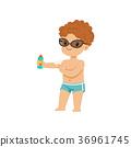 Cute little boy applying sunscreen, kid playing at 36961745
