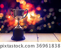 Win prize trophy on wood table with abstract bokeh 36961838