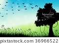 Field of grass background with silhouette tree and 36966522