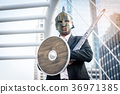 Knight businessman wearing an helm and steel sword 36971385