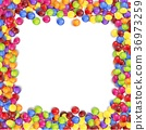 Frame of colorful candy on a white background 36973259