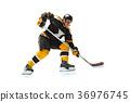 one caucasian man hockey player in studio 36976745