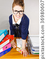Happy business woman in office 36980607