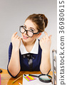 Happy business woman in office 36980615