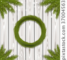 Fir wreath and branches on a wooden background 37004563