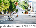 mom with a stroller crosses the road 37012279
