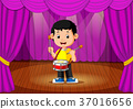 Cute boy playing drum on stage 37016656