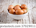 fresh eggs in a bowl 37029011