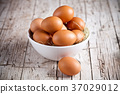 fresh eggs in a bowl 37029012