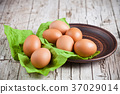fresh brown eggs in plate and green napkin 37029014