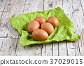 fresh brown eggs on green napkin 37029015