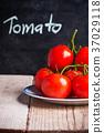fresh tomatoes and blackboard 37029118