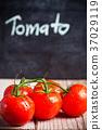 fresh tomatoes and blackboard 37029119