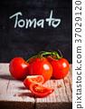 fresh tomatoes and blackboard 37029120