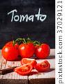 fresh tomatoes, knife and blackboard 37029121