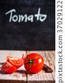 fresh tomatoes and blackboard 37029122