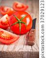 fresh tomatoes and knife 37029123