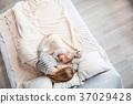 Woman hugging her daughter while sleeping 37029428