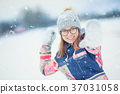 Winter girl  playing in snow throwing snowball. 37031058