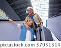Optimistic old woman and little girl are moving on 37031314