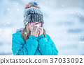 Girl with allergy symptom blowing nose in winter. 37033092
