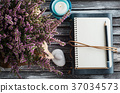 Notebook, heather flowers, candles 37034573