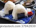 Traditional Japanese Onigiri with Umeboshi  37042630