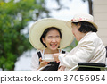 Elderly woman relax in backyard with daughter 37056954