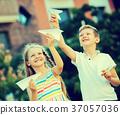 kids playing airplane toys 37057036