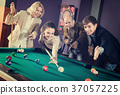 Group of adults playing pool. 37057225