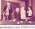 people having pool game 37057243